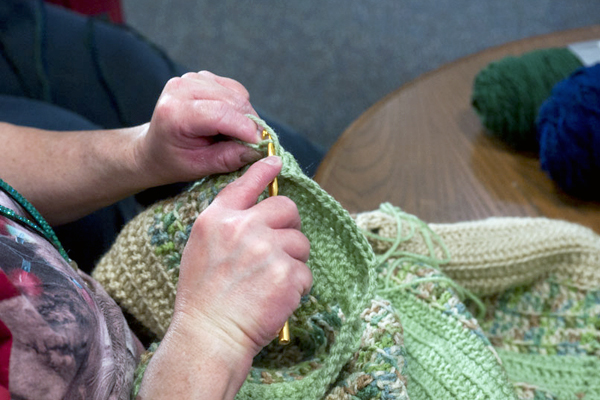 Photo of a library patron crocheting.