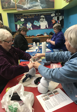 Photo of Garland County Library patrons making a craft